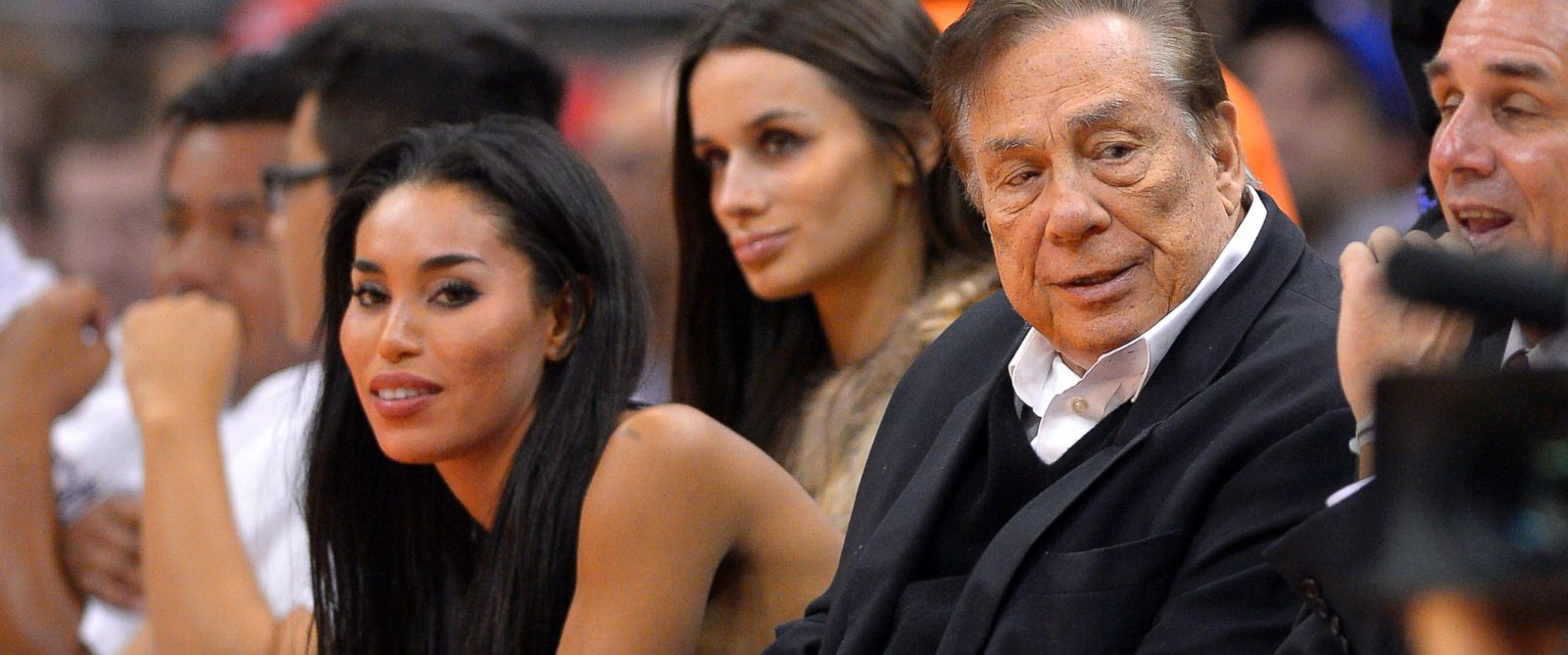 PHOTO: Los Angeles Clippers owner Donald Sterling and V. Stiviano, seated to his right, watch the Clippers play the Sacramento Kings, Oct. 25, 2013, in Los Angeles.