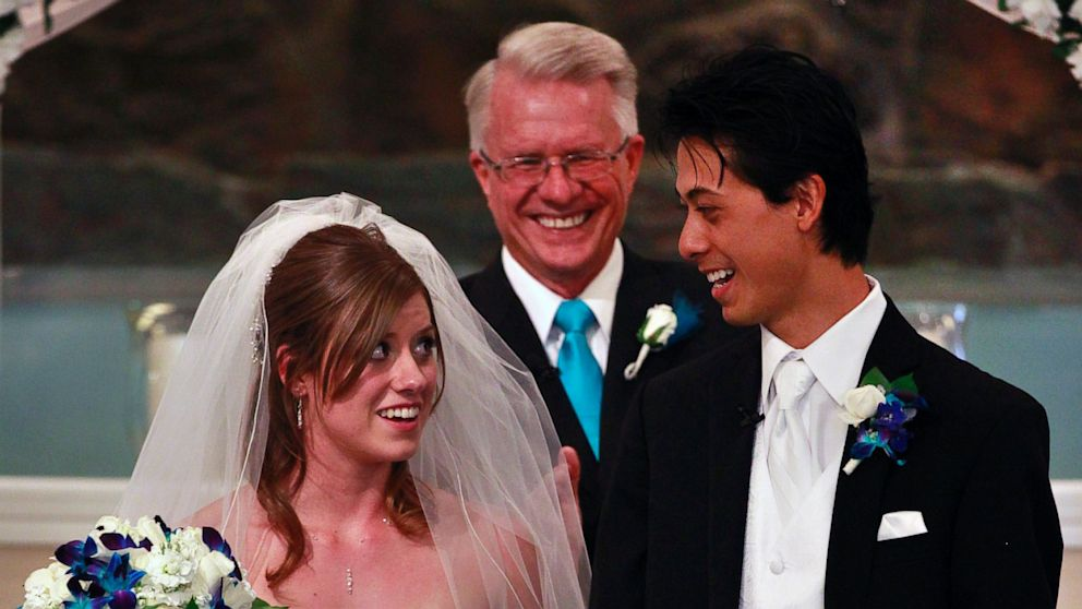 PHOTO: Aurora shooting survivors, and now newlyweds, Eugene and Kirstin Han smile at each