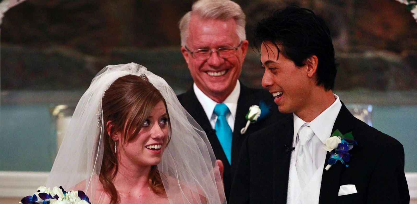 PHOTO: Aurora shooting survivors, and now newlyweds, Eugene and Kirstin Han smile at each other after exchanging vows during their wedding ceremony at Village East Baptist Church, in Aurora, Colo. Saturday July 20, 2013.