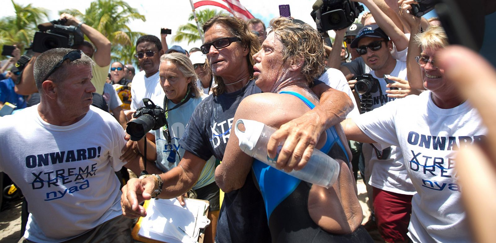 PHOTO: Endurance swimmer Diana Nyad, right, and her trainer, Bonnie Stoll hug after Nyad walks ashore, Sept. 2, 2013, in Key West, Fla. after swimming from Cuba.