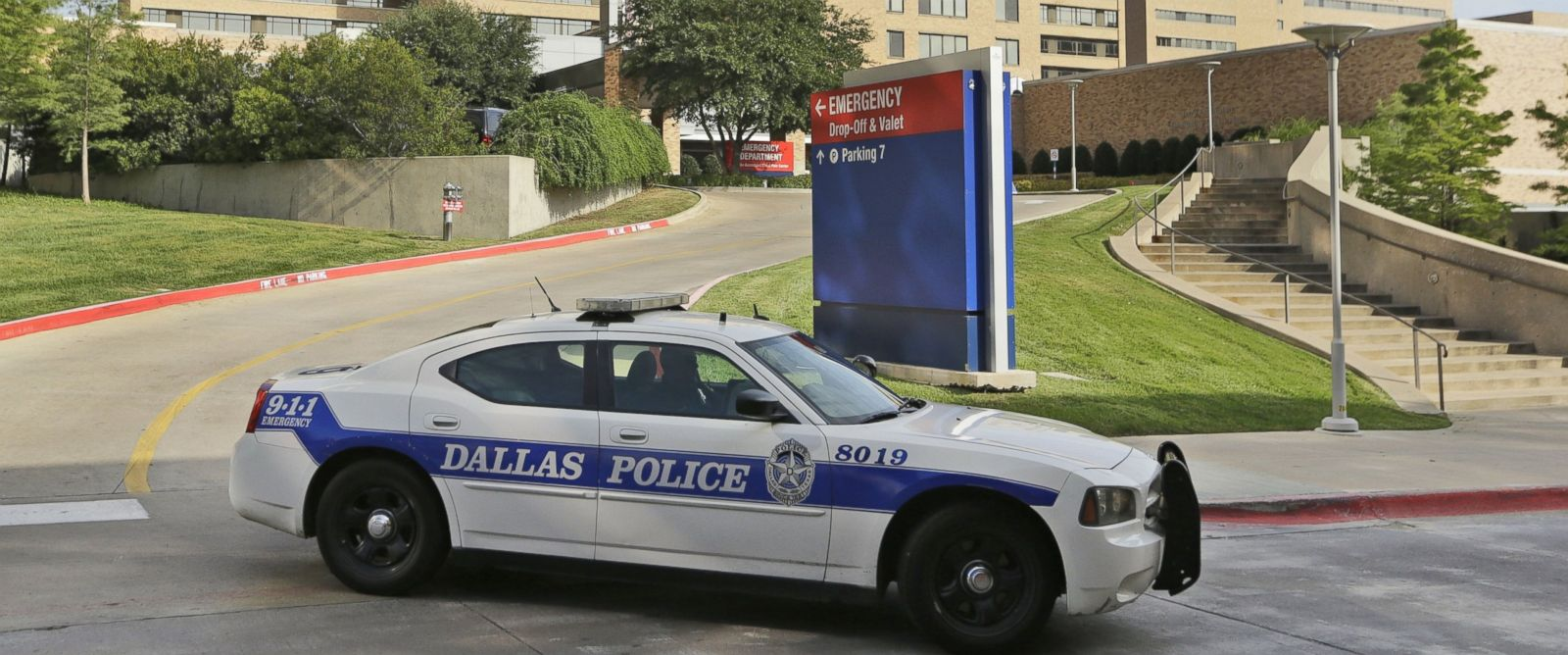 PHOTO: A police car drives past the entrance to the Texas Health Presbyterian Hospital in Dallas