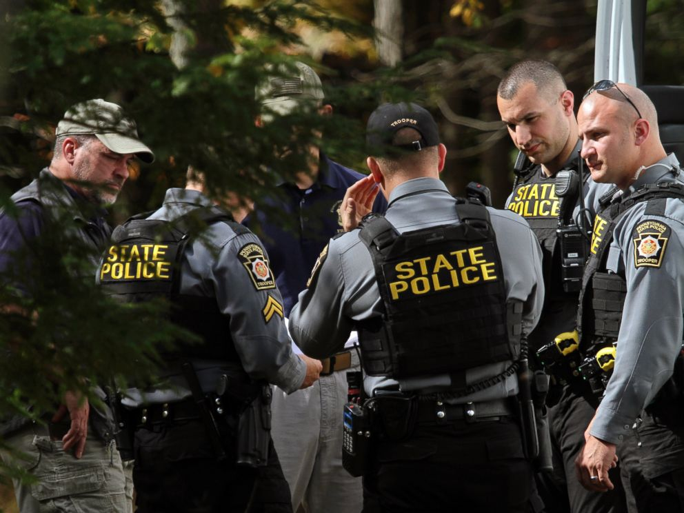 PHOTO: Pennsylvania State Police conferred along Snow Hill Road in Price Township, Pennsylvania, Sept. 30, 2014, as the search for suspected killer Eric Frein carried on for the 18th day.