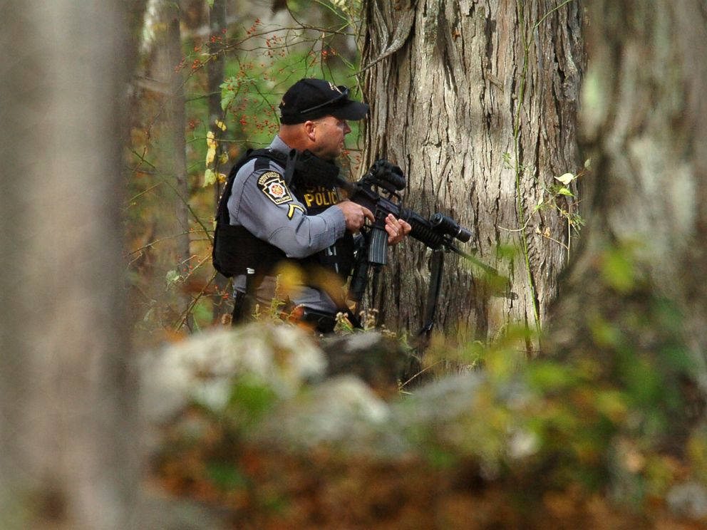 PHOTO: A Pennsylvania State Trooper searches the woods near Lower Swiftwater Road in Swiftwater, Pa., Oct. 18, 2014 during a massive manhunt for killer Eric Frein.