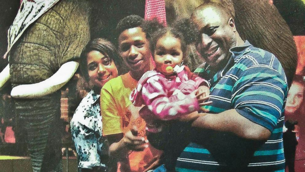 PHOTO: Eric Garner, right, poses with his children