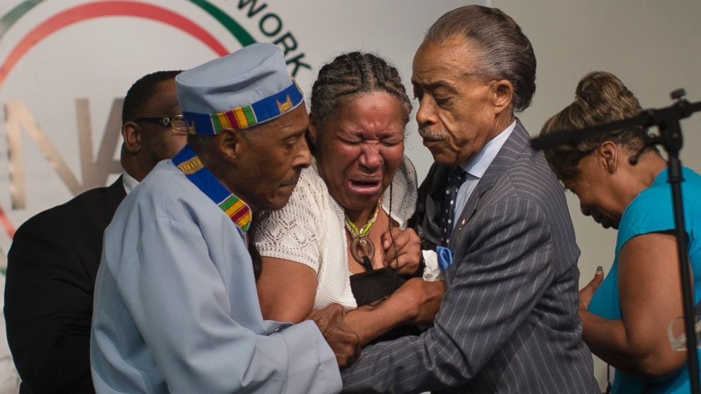 PHOTO: Esaw Garner, wife of Eric Garner, breaks down in the arms of Rev. Herbert Daughtry, center, and Rev. Al Sharpton, right, during a rally at the National Action Network headquarters for Eric Garner, Saturday, July 19, 2014, in New York.