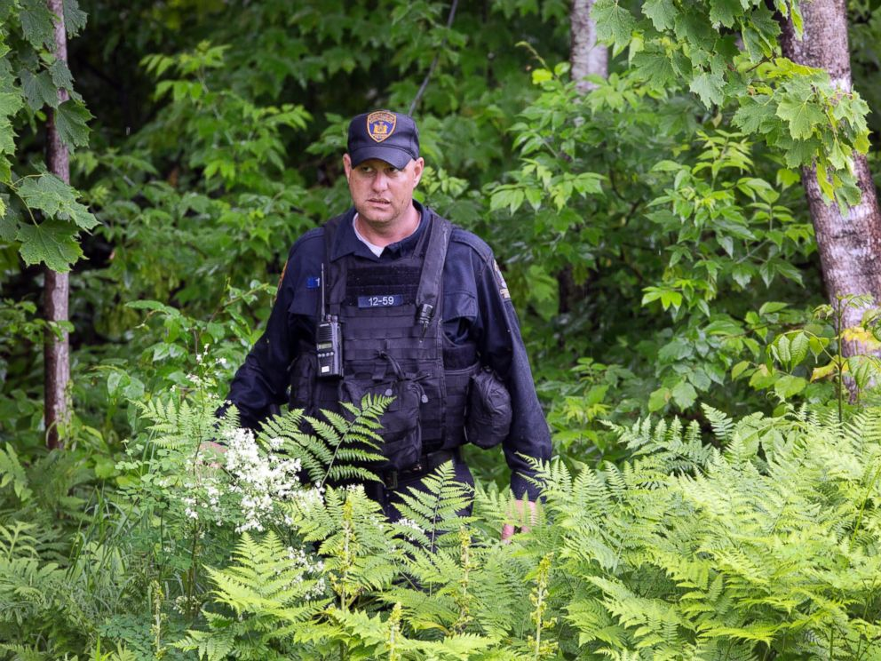PHOTO: A corrections officer emerges from the woods after searching with a team near the Clinton Correctional Facility, June 16, 2015, Dannemora, N.Y.