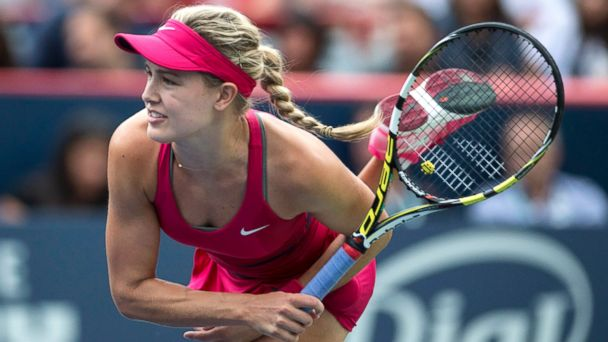 PHOTO: Eugenie Bouchard, of Canada, serves to Shelby Rogers, of the United States, at the Rogers Cup tennis tournament, Aug. 5, 2014, in Montreal.