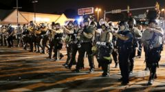 PHOTO: Police advance to clear people Monday, Aug. 18, 2014, during a protest for Michael Brown, who was killed by a police officer Aug. 9 in Ferguson, Mo.
