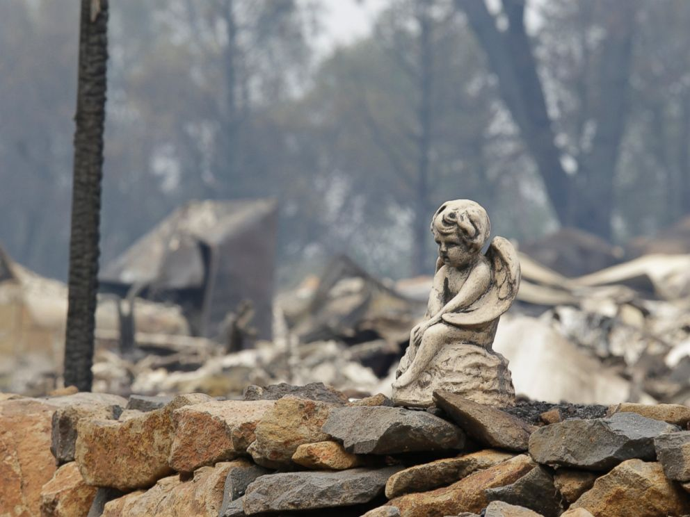 PHOTO: The figure sits on a rock wall outside a hillside home destroyed by fire, Sept. 13, 2015, in Hidden Valley, Calif.