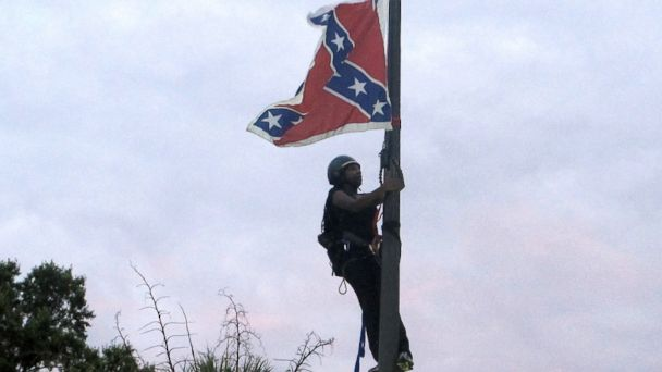http://a.abcnews.com/images/US/AP_flag_removal_arrest_mm_150702_16x9_608.jpg