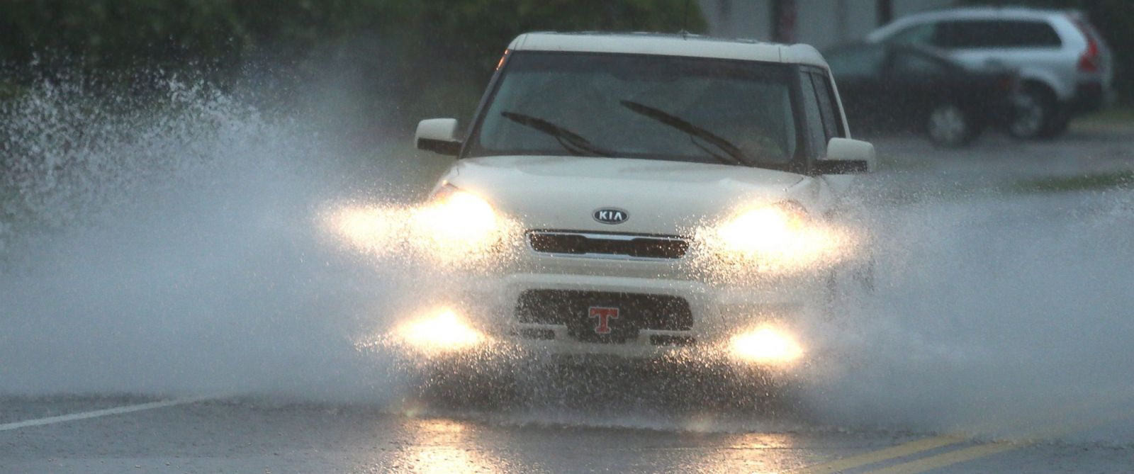 PHOTO: A vehicle drives through heavy flooding on Thomas Drive during rush hour in Panama City, Fla.