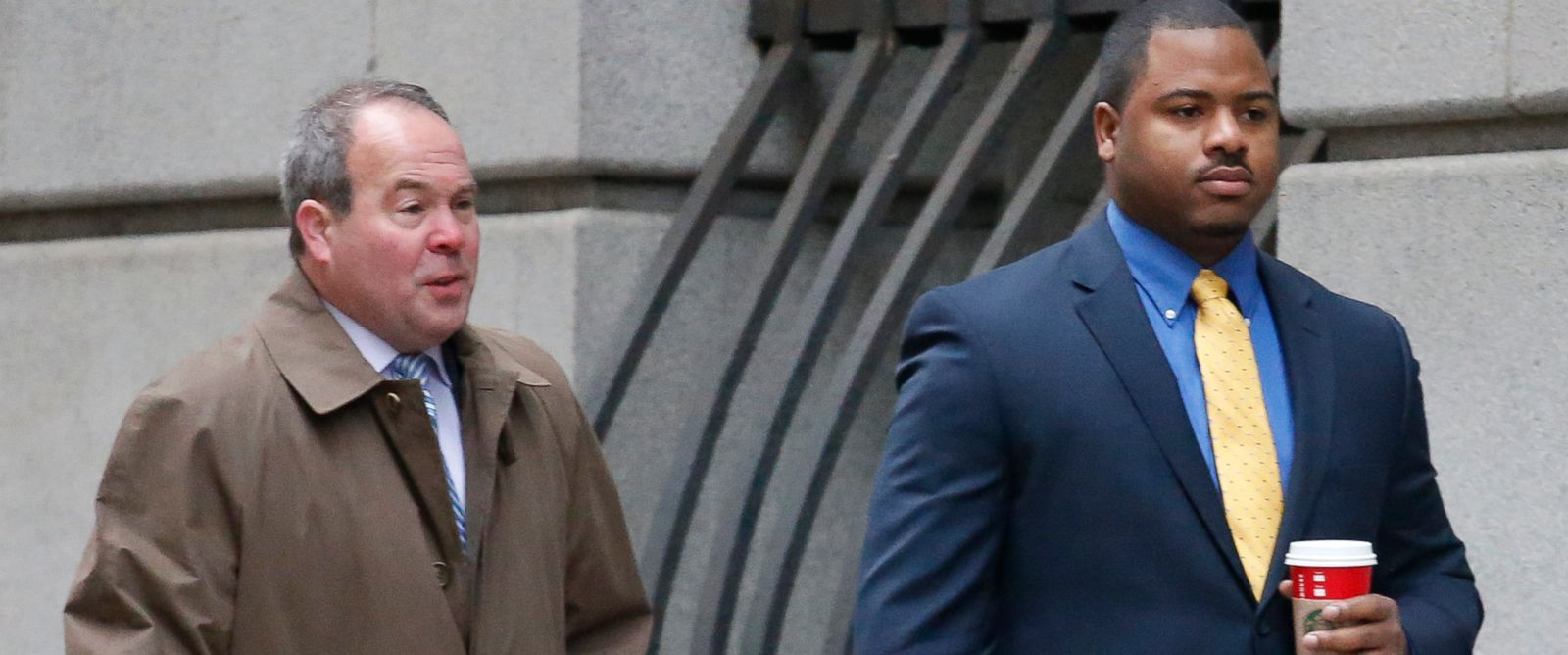 PHOTO:William Porter, right, one of six Baltimore city police officers charged in connection to the death of Freddie Gray, walks into a courthouse with his attorney Joseph Murtha for jury selection in his trial, Nov. 30, 2015, in Baltimore.