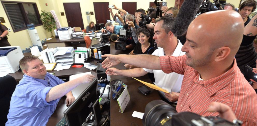 PHOTO: Rowan County deputy clerk Brian Mason, left, shakes hands with James Yates, and his partner William Smith Jr., after issuing their their marriage license at the Rowan County Judicial Center in Morehead, Ky., Sept. 4, 2015.