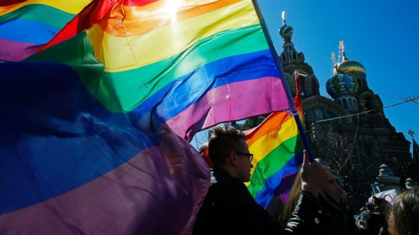 PHOTO: Gay rights activists carry rainbow flags as they march during a May Day rally in St. Petersburg, Russia on Wednesday, May 1, 2013.