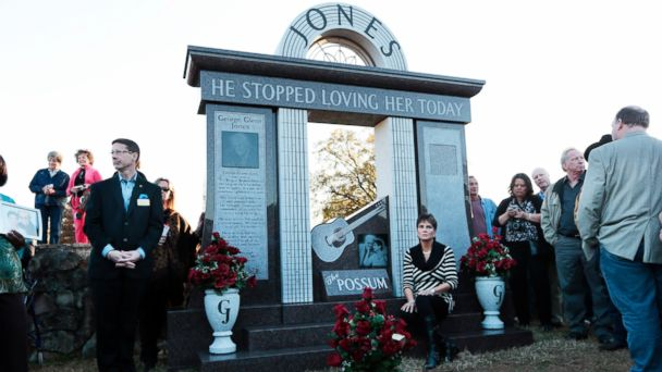 PHOTO: Nancy Jones, widow of country music star George Jones, listens as the Jones Boys band plays as she sits at the memorial unveiled at the late singers grave Nov. 18, 2013, in Nashville, Tenn.