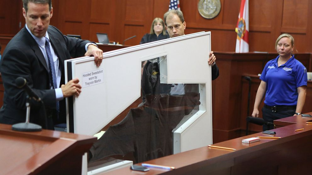 PHOTO: John Guy and Richard Mantei present Trayvon Martins hooded sweatshirt as evidence at Zimmerman trial