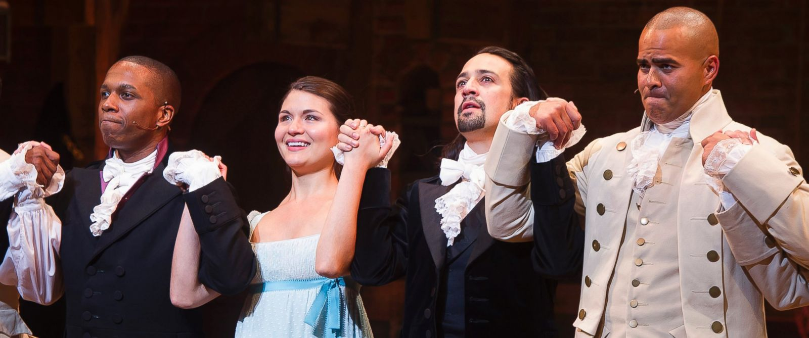 "PHOTO: Leslie Odom Jr., from left, Phillipa Soo, Lin-Manuel Miranda and Christopher Jackson appear at the curtain call following the opening night performance of ""Hamilton"" at the Richard Rodgers Theatre in New York, Aug. 6, 2015."