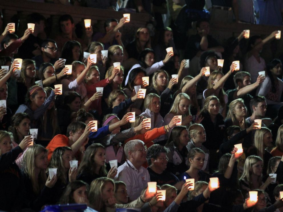 PHOTO: Students, teachers and parents raise their candles in support of missing U.Va. student Hannah Elizabeth during a student led vigil, Sept. 18, 2014, at the University of Virginia in Charlottesville, Va.