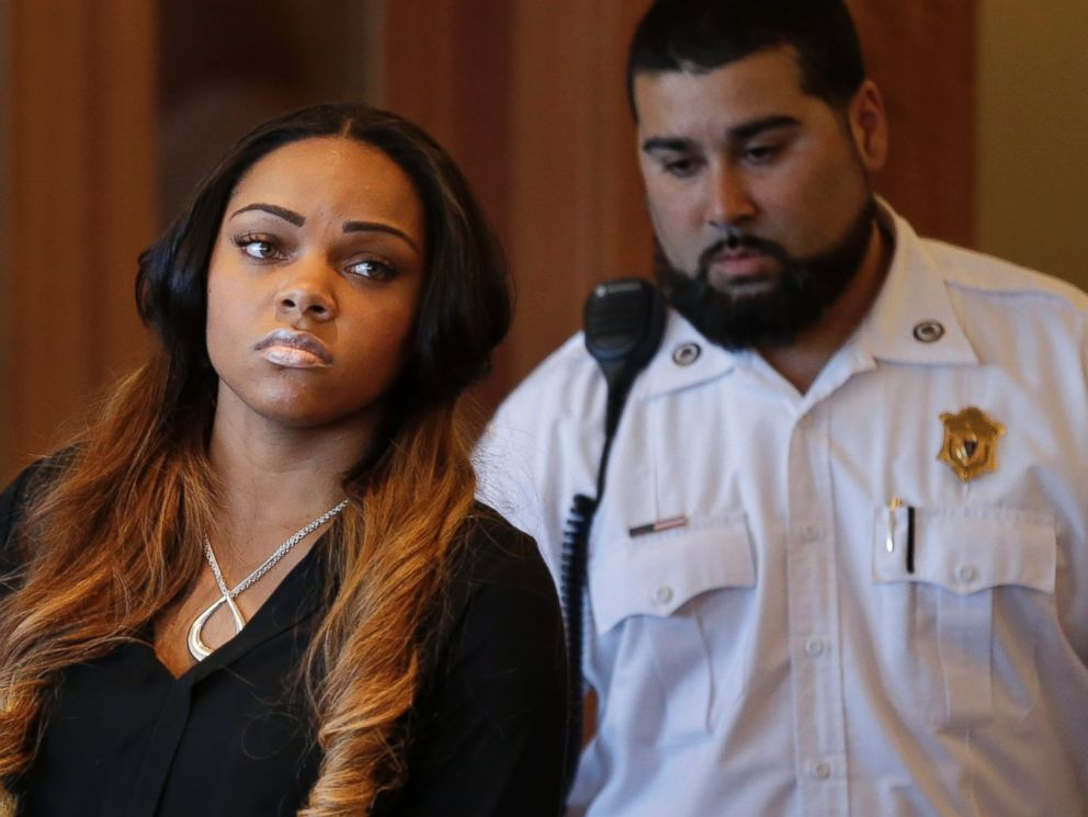 PHOTO: Shayanna Jenkins, left, girlfriend of former New England Patriots Aaron Hernandez, appears in superior court, during her arraignment on a perjury charge in connection with the killing of Hernandezs friend, in Fall River, Mass. on Oct. 15, 2013.