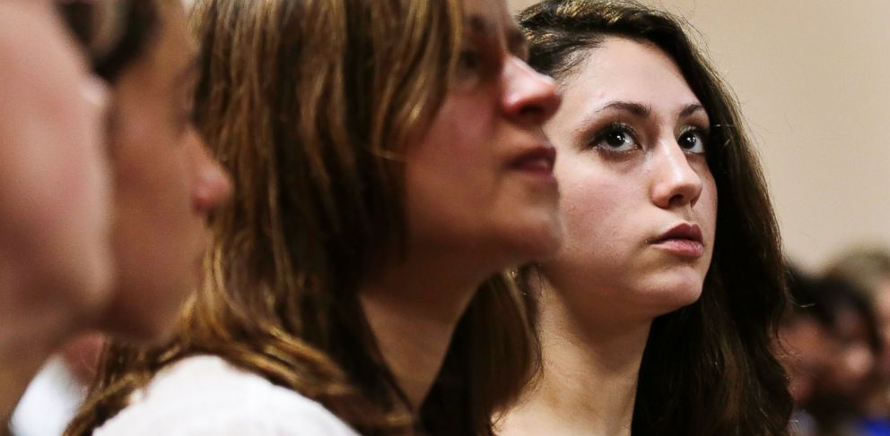 PHOTO: Abigail Hernandez, right, sits with family and friends as she listens to her mother Zenya Hernandez, center, talk with N.H. Senior Assistant Attorney General Jane Young at Conway District Court in Conway, N.H., July 29, 2014.