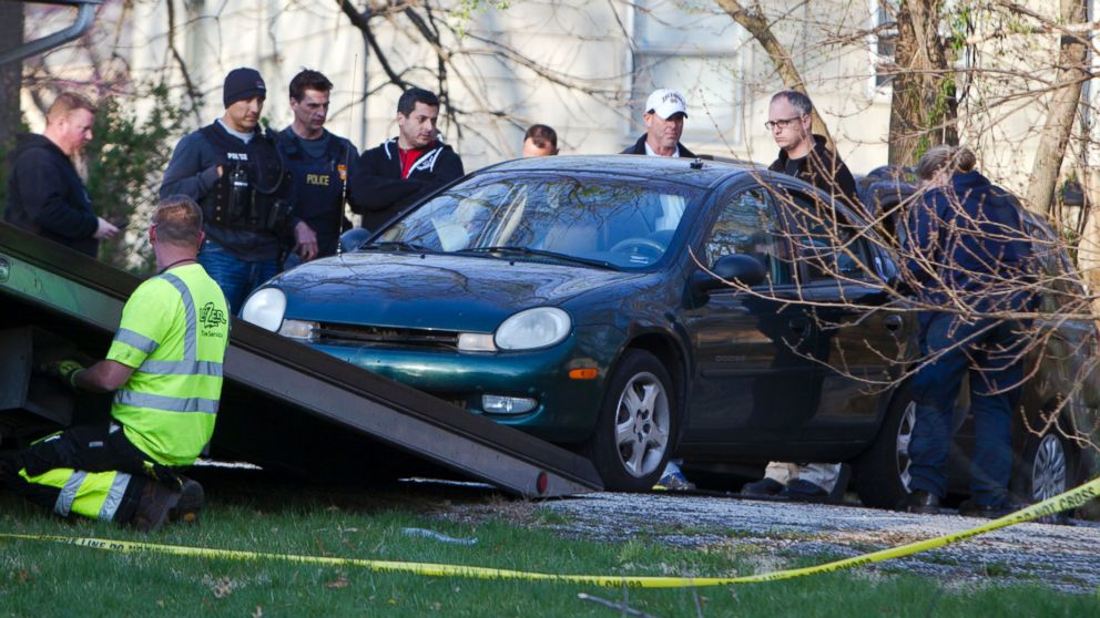 PHOTO: A car is removed by Kansas City police from the house, far right, of a Grandview man suspected in a series of shootings that have occurred on area roadways since early March, according to Police Chief Darryl Forté.