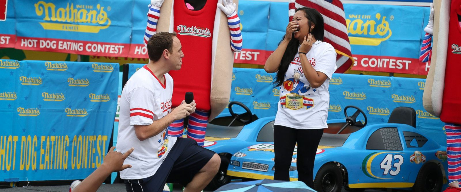PHOTO: Competitive eater Joey Chestnut proposes to his girlfriend and fellow competitor Neslie Ricasa before the Nathans Famous Fourth of July International Hot Dog Eating contest at Coney Island, July 4, 2014, in New York.