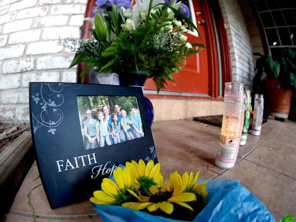 PHOTO: A photograph, flowers and candles are left on the porch where a fatal home shooting took place, July 10, 2014, in Spring, Texas.