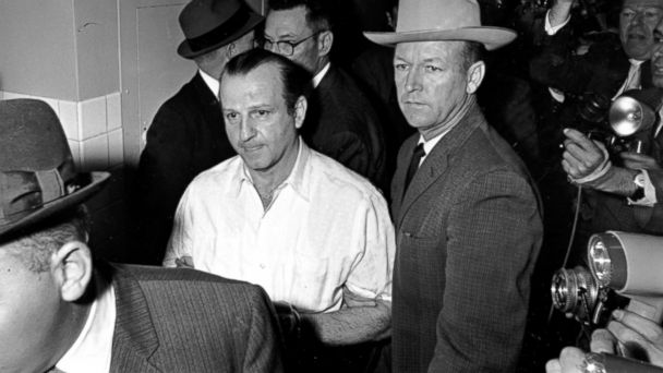 PHOTO: Jack Ruby is led through the Dallas city jail on his way to his arraignment