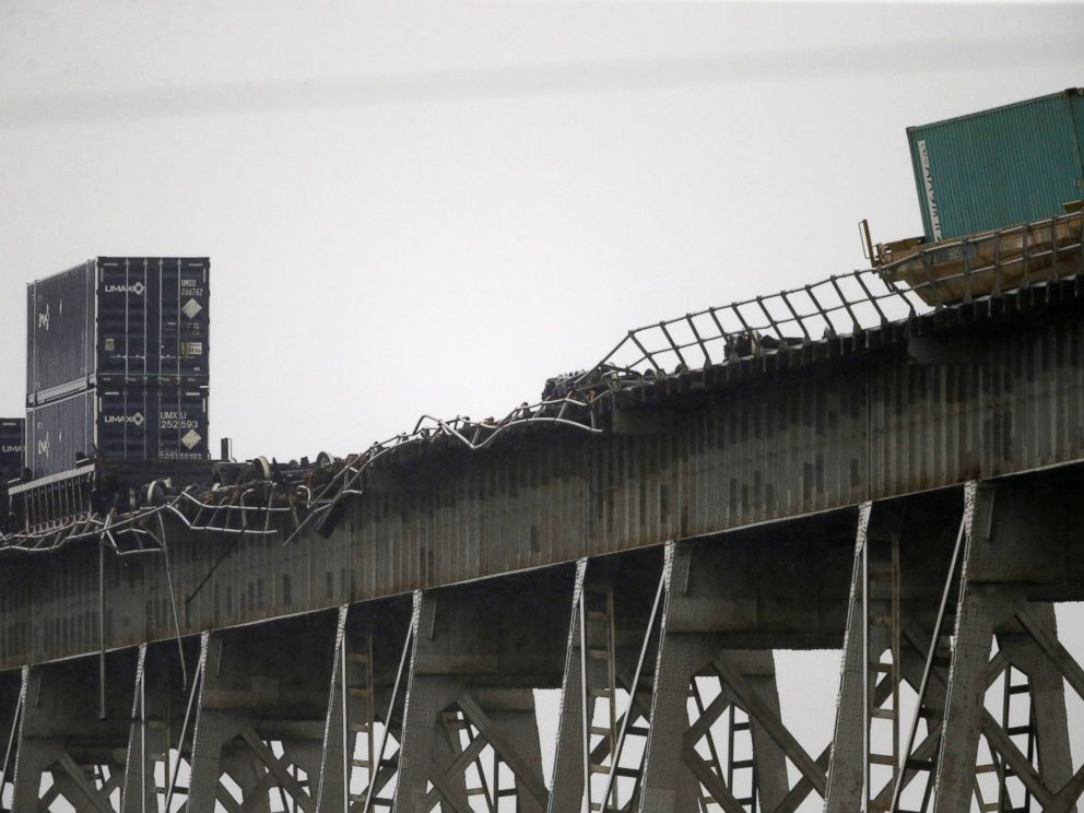 PHOTO: Broken railing and train cars are seen on the Huey P. Long Bridge, which crosses over the Mississippi River, after several cars toppled from high winds in Jefferson Parish, La., just outside New Orleans, April 27, 2015.