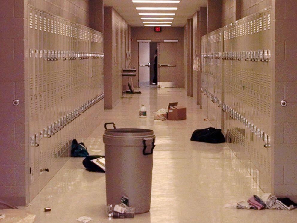 PHOTO: Backpacks and cleaning supplies lie in the hallway of Westside Middle School in Jonesboro, Ark., March 25, 1998. The view is from a door used by students to leave the building during a false fire alarm, followed by a shooting.