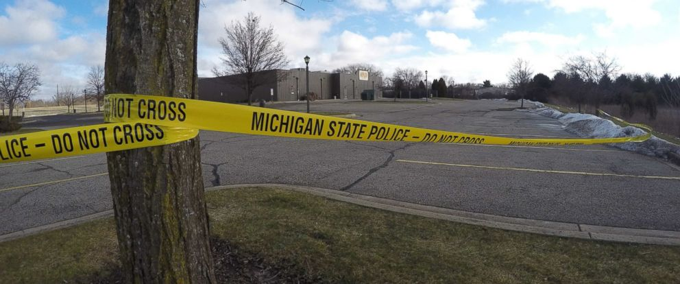 PHOTO: Police tape surrounds the area of a random shooting, Feb. 21, 2016, in Kalamazoo, Mich.