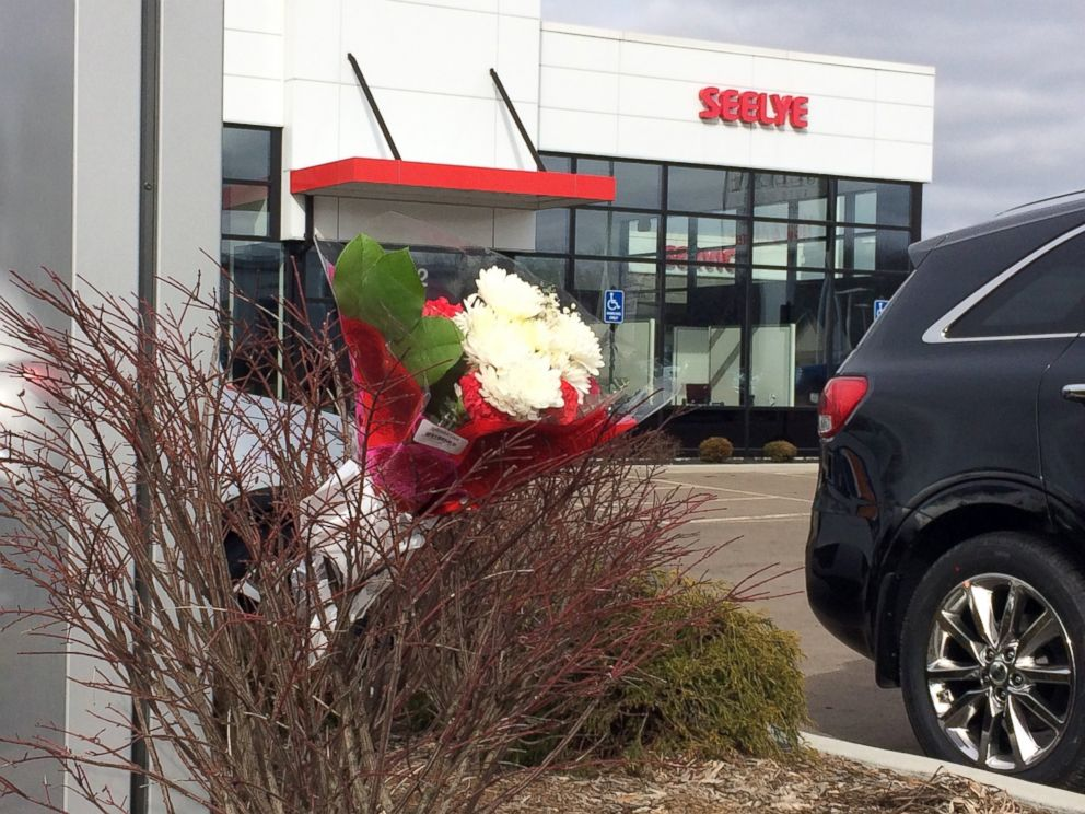 PHOTO: Flowers are place in front of a car dealership, the scene of a random shooting, Feb. 21, 2016 in Kalamazoo, Mich.