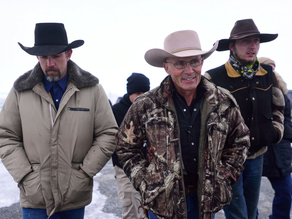 PHOTO: Occupier Robert LaVoy Finicum, center, speaks to press at the Malheur National Wildlife Refuge headquarters near Burns, Ore., on Jan. 9, 2016.