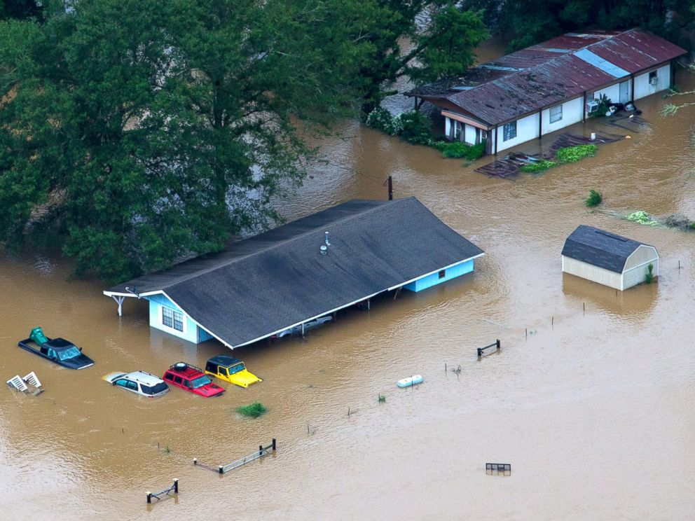 PHOTO: In this aerial photo, rescue officials and civilians alike work to pull people from their flooded homes along the flooded Tangipahoa River near Amite, Independence, Tickfaw and Robert, Louisiana, Aug. 13, 2016.