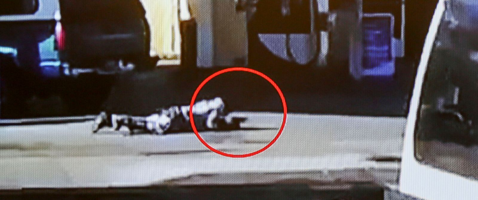 PHOTO: In this image made from security video footage provided by the Los Angeles County Sheriff, Nicholas Robertson is stretched out on the ground with a gun in his hand after he was shot by Los Angeles deputies, Dec. 12, 2015 in Lynwood, Calif.