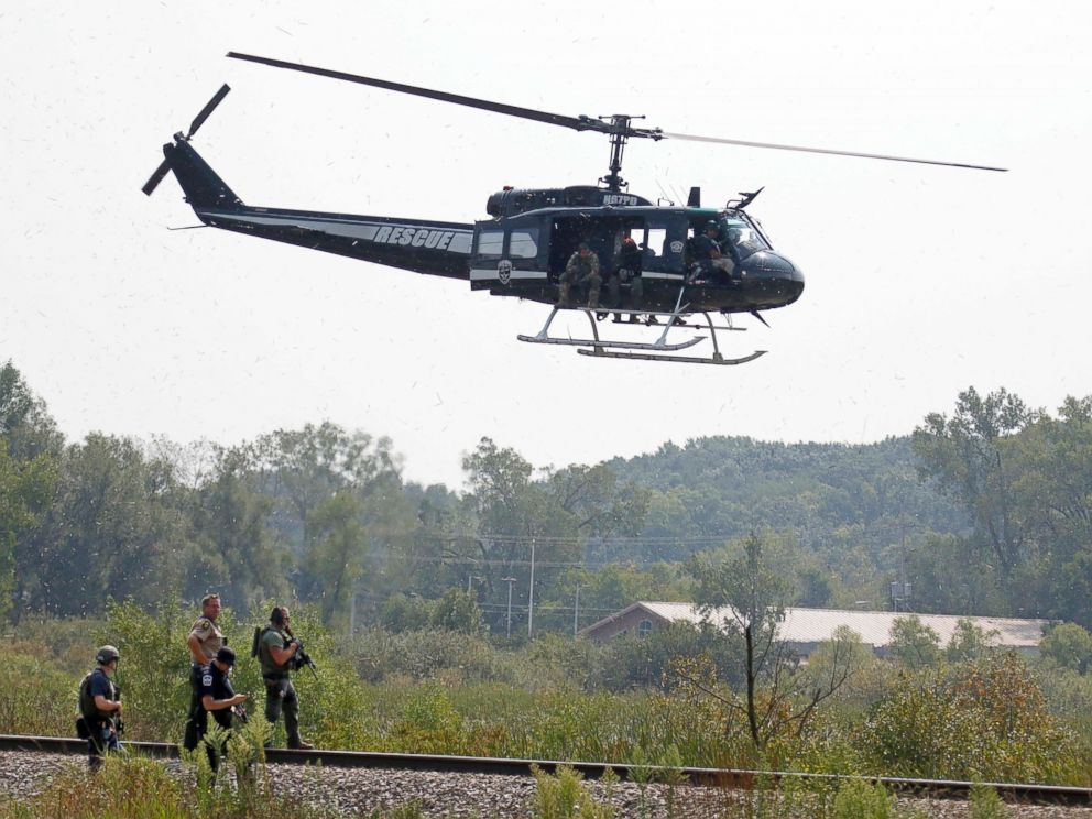 PHOTO:Police on foot and in the air search for suspects in the shooting of a police officer, Sept. 1, 2015, in Fox Lake, Ill.