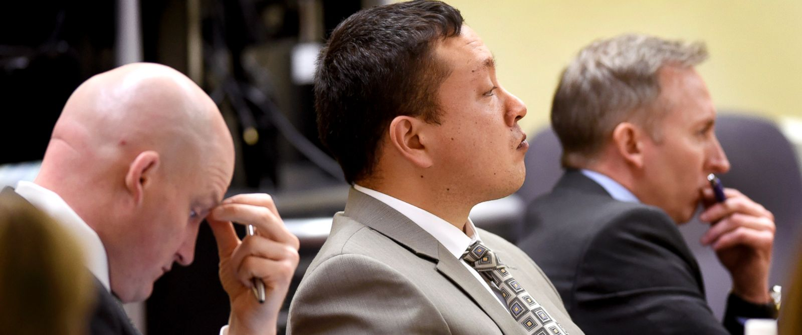 Markus Kaarma, center, is flanked by his defense attorneys, Brian Smith, left, and Paul Ryan, as he listens to testimony during his trial in Missoula, Mont., in the shooting death of Diren Dede, in this Dec. 8, 2014, file photo.