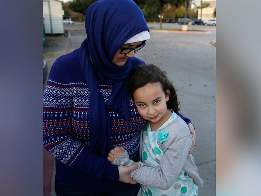 PHOTO: Sofia Yassini, 8, right, gets a hug from her mother Melissa Yassini after posing for a photo outside a mosque in Richardson, Texas, Dec. 11, 2015.