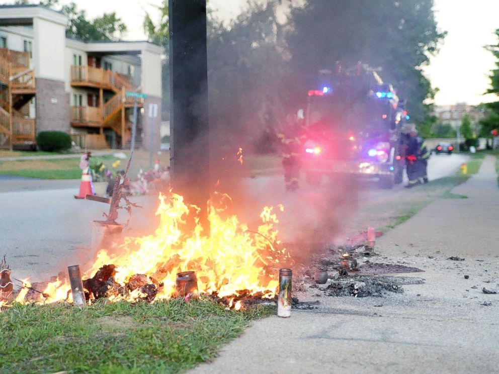 PHOTO: A fire burns, Sept. 23, 2014, at a memorial in Ferguson, Mo., on the site where a Missouri police officer fatally shot 18-year-old Michael Brown.