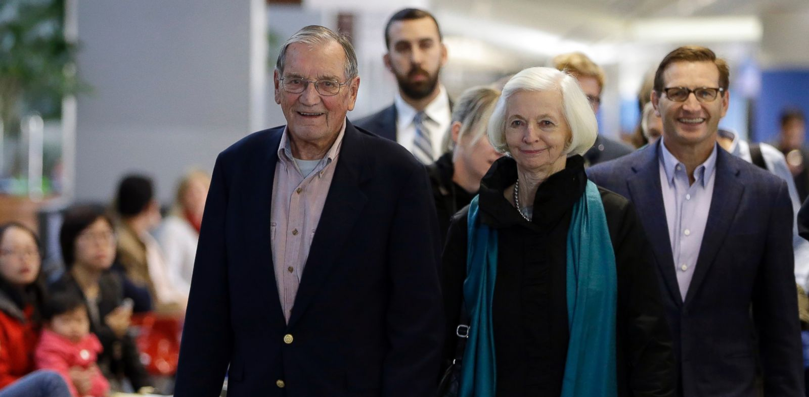PHOTO: Merrill Newman, left, walks beside his wife Lee and son Jeffrey after arriving at San Francisco International Airport, Saturday, Dec. 6, 2013, in San Francisco.
