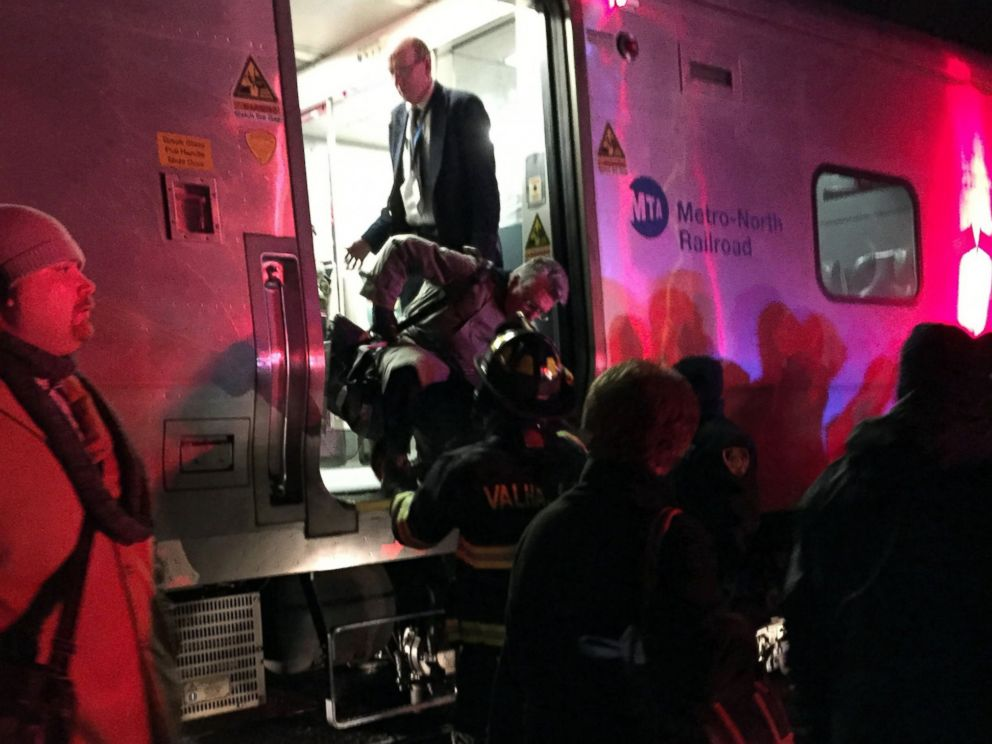 PHOTO: Passengers are assisted off a Metro-North Railroad passenger train in Valhalla, N.Y., Feb. 3, 2015.