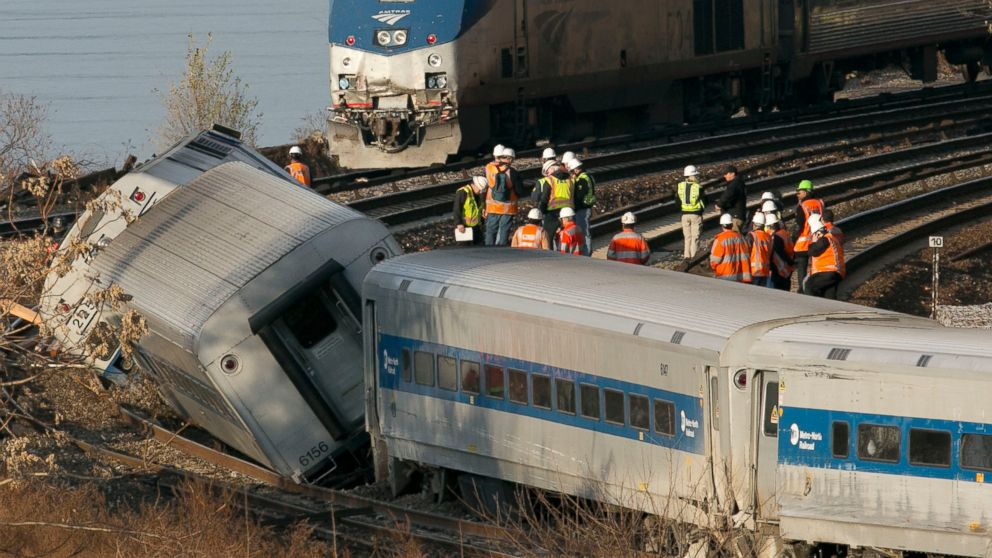PHOTO: An Amtrak train traveling on an unaffected track, passes a
