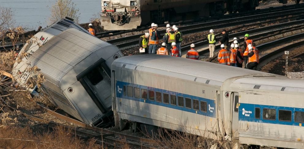 PHOTO: An Amtrak train traveling on an unaffected track, passes a derailed Metro North commuter train, Dec. 1, 2013, in the Bronx, New York.