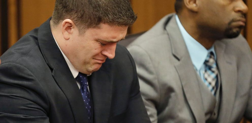 PHOTO: Michael Brelo weeps as he hears the verdict in his trial Saturday, May 23, 2015, in Cleveland.