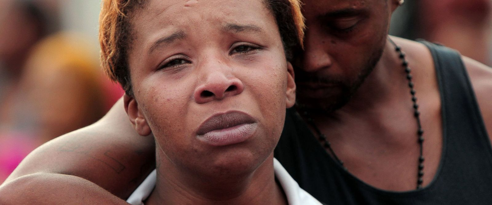 PHOTO: Lesley McSpadden, left, is comforted by her husband, Louis Head, after her 18-year-old son, Michael Brown was shot and killed by police in the middle of the street in Ferguson, Mo., near St. Louis on Saturday, Aug. 9, 2014.