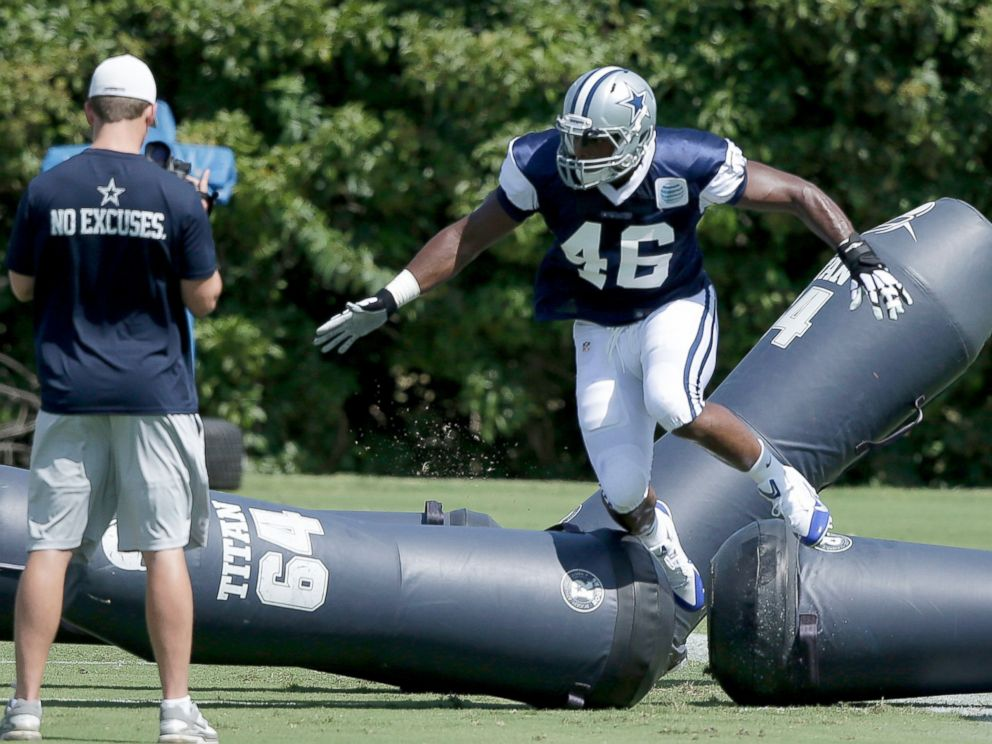 PHOTO: Dallas Cowboys practice squad player defensive end Michael Sam (46) warms up on the field during team practice, Sept. 3, 2014, in Irving, Texas.