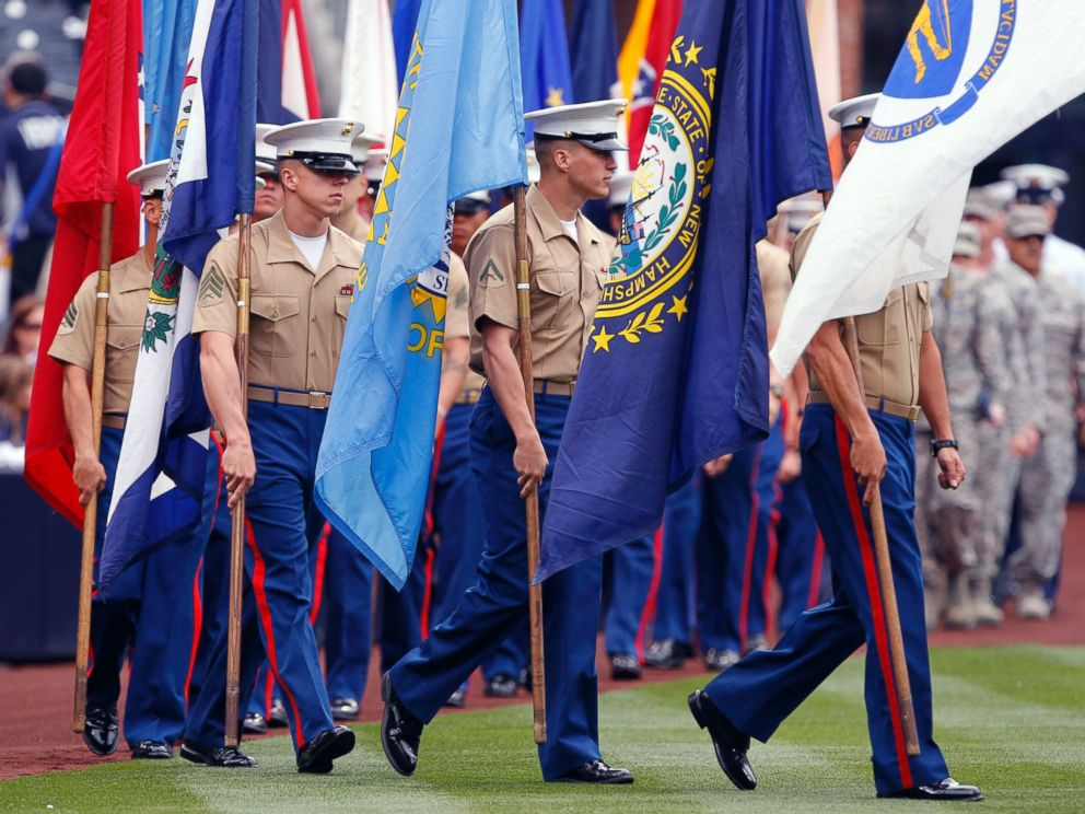 PHOTO:Members of the military walk onto the field for pre-game ceremonies prior to the Colorado Rockies playing the San Diego Padres in a baseball game, April 14, 2013, in San Diego.