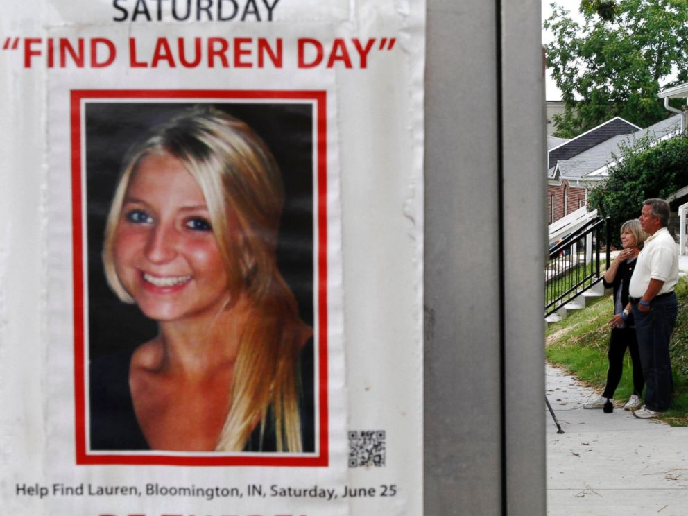 PHOTO: Charlene and Robert Spierer speak to reporters near a poster alerting people to their missing daughter, Lauren, August 15th, 2011 in Bloomington, Ind.