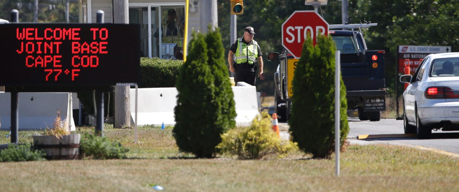 PHOTO: Vehicles are stopped by security personal as they enter a gate on Sept. 22, 2014, to Camp Edwards, Mass., on Cape Cod.