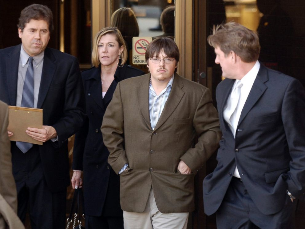 PHOTO: Defense attorney John B. Schisler, second from left, and his client Mitchell Johnson, 23, second from right, walk out of the Federal Building during a lunch break from Johnsons trial, Jan. 29, 2008, in Fayetteville, Ark.